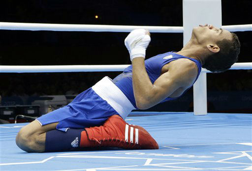 Cuba&#39;s Robeisy Ramirez Carrazana reacts after being declared the winner over Mongolia&#39;s Tugstsogt Nyambayar in their flyweight 52-kg gold medal boxing match at the 2012 Summer Olympics, Sunday, Aug. 12, 2012, in London. &#40;AP Photo&#47;Patrick Semansky&#41; <span class=meta>(AP Photo&#47; Patrick Semansky)</span>