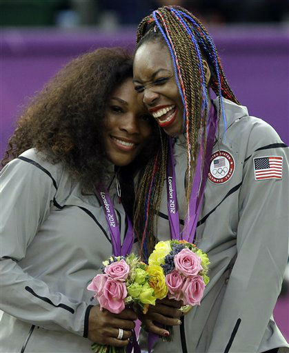 Serena Williams, left, and Venus Williams of the United States laugh together on the podium after receiving their gold medals in women&#39;s doubles at the All England Lawn Tennis Club in Wimbledon, London at the 2012 Summer Olympics, Sunday, Aug. 5, 2012. &#40;AP Photo&#47;Elise Amendola&#41; <span class=meta>(AP Photo&#47; Elise Amendola)</span>