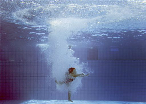 A girl jumps into the cold water of a public swimming pool in Essen, Germany, Wednesday, July 25, 2012. Germany faces sunny and hot weather with temperatures over 30 Celsius &#40;86F&#41; for the next few days. &#40;AP Photo&#47;Frank Augstein&#41; <span class=meta>(AP Photo&#47; Frank Augstein)</span>