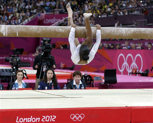 U.S. gymnast Gabrielle Douglas loses her balance and hangs onto the balance beam during the artistic gymnastics women&#39;s apparatus finals at the 2012 Summer Olympics, Tuesday, Aug. 7, 2012, in London. &#40;AP Photo&#47;Julie Jacobson&#41; <span class=meta>(AP Photo&#47; Julie Jacobson)</span>