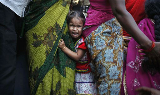A young Indian child cries as police detain activists of Communist Party of India Marxist &#40;CPIM&#41; during a protest in Hyderabad, India, Monday, Dec. 10, 2012. The protesters staged a demonstration in front of the district administrator?s office against the hike of electrical and water prices demanding the government to resolve the problems of the people immediately. &#40;AP Photo&#47;Mahesh Kumar A.&#41; <span class=meta>(AP Photo&#47; Mahesh Kumar A)</span>
