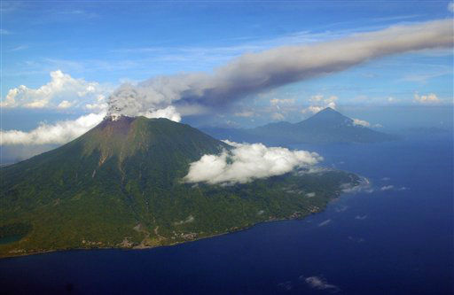 In this Sunday, Sept. 16, 2012 aerial shot, Mount Gamalama spews volcanic ash as it erupts on Ternate Island, eastern Indonesia. The volcano has erupted, spewing clouds of thick, gray ash. There were no immediate reports of injuries or damage. &#40;AP Photo&#41; <span class=meta>(AP Photo&#47; Uncredited)</span>