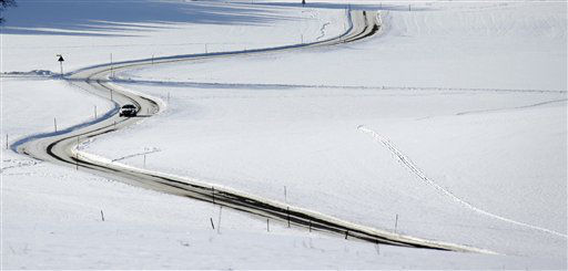 A car drives through a snow covered landscape near Starnberg, southern Germany, Thursday, Dec. 13, 2012. Weather forecasts predict changeable weather with rising temperatures for Germany during the coming days. &#40;AP Photo&#47;Matthias Schrader&#41; <span class=meta>(AP Photo&#47; Matthias Schrader)</span>