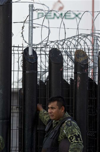 A Mexican army soldier guards the entrance to a PEMEX facility after an explosion at  a gas pipeline distribution center in Reynosa, Mexico near Mexico&#39;s border with the United States, Tuesday Sept. 18, 2012. A big fire erupted at a natural gas pipeline distribution center on Tuesday, and 26 people were reported killed. &#40;AP Photo&#47;Hans Maximo Musielik&#41; <span class=meta>(AP Photo&#47; Hans Maximo Musielik)</span>