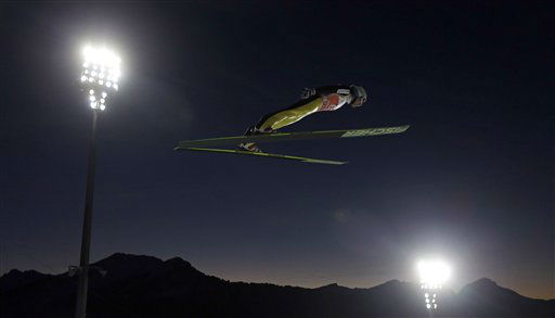 Switzerland's Simon Ammann soars through the air during his qualifying jump of the first stage of the four hills ski jumping tournament in Oberstdorf, southern Germany, Saturday, Dec. 29, 2012. (AP Photo/Matthias Schrader)