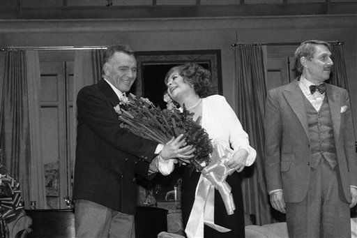 Elizabeth Taylor, center, receives roses from Richard Burton, left, during curtain call at the Broadway opening of Noel Coward?s play ?Private Lives,? Sunday, May 8, 1983, New York. Coward?s classic ?Private Lives? is about a divorced pair who falls in love all over again while honeymooning with other spouses. The man on the right is unidentified. &#40;AP Photo&#47;Rene Perez&#41; <span class=meta>(AP Photo&#47; Rene Perez)</span>