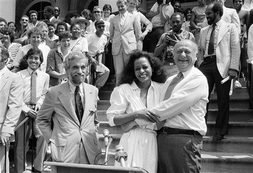 New York City Mayor Ed Koch hugs singer-actress Diana Ross at the steps of City Hall in Manhattan, New York, Wednesday, July 6, 1938. Ross announced that she will give a free concert in Central Park on July 12 which will benefit the city?s parks. The concert, titled ?Diana Ross World-wide From New York: For One and For All?, will be televised lived from Central Park on Pay-TV in the United States and commercial television word-wide via satellite. &#40;AP Photo&#47;Marty Lederhandler&#41; <span class=meta>(AP Photo&#47; Marty Lederhandler)</span>