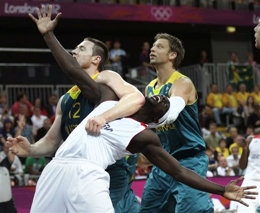 Australia&#39;s Aron Baynes, left, and David Andersen keep Britain&#39;s Pops Mensah-Bonsu, center, away from a rebound during a men&#39;s basketball game at the 2012 Summer Olympics, Saturday, Aug. 4, 2012, in London. &#40;AP Photo&#47;Charles Krupa&#41; <span class=meta>(AP Photo&#47; Charles Krupa)</span>