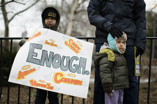 Dmitri Wild-Arons, 6, of Brooklyn, holds a sign listing several of the biggest mass shootings in United States history in Cadman Park before the One Million Moms for Gun Control Rally and march over the Brooklyn bridge, Jan. 21, 2012, in New York. Demonstrators called for new gun control legislation, demanding a ban on assault weapons and stricter regulations on gun purchases.The One Million Moms for Gun Control group formed in the wake of last month&#39;s massacre at a Connecticut elementary school. &#40;AP Photo&#47;John Minchillo&#41; <span class=meta>(AP Photo&#47; John Minchillo)</span>