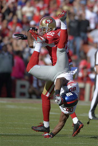 New York Giants wide receiver Victor Cruz &#40;80&#41; is flipped over by San Francisco 49ers cornerback Carlos Rogers &#40;22&#41; during on an incomplete pass during the second half of an NFL football game in San Francisco, Sunday, Oct. 14, 2012. &#40;AP Photo&#47;Mark J. Terrill&#41; <span class=meta>(AP Photo&#47; Mark J. Terrill)</span>