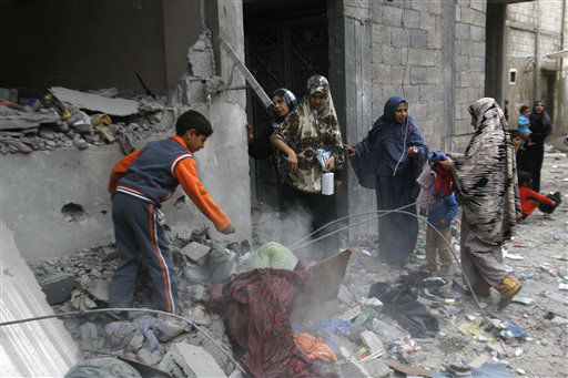 "<div class=""meta ""><span class=""caption-text "">Palestinians collect their belongings in the rubble of a destroyed house after an Israeli airstrike in the Jebaliya refugee camp, northern Gaza Strip, Saturday, Nov. 17, 2012. Israel bombarded the Hamas-ruled Gaza Strip with more than 180 airstrikes early Saturday, widening a blistering assault on militant operations to include government and police compounds, militant leaders? residences and a vast network of smuggling tunnels. (AP Photo/Hatem Moussa) (AP Photo/ Hatem Moussa)</span></div>"