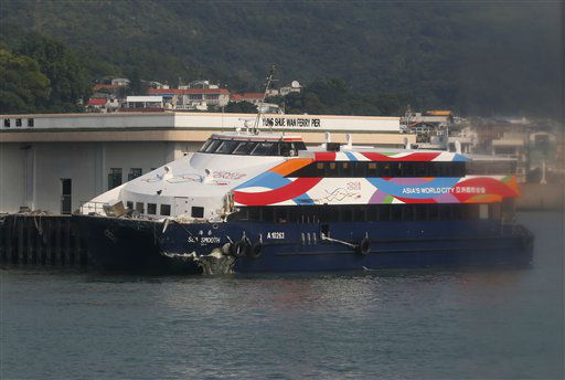 A damaged ferry is docked at a pier after a collision in Lamma Island, off the southwestern coast of Hong Kong Tuesday, Oct. 2, 2012. The ferry on Monday collided with a boat owned by utility company Power Assets Holdings Ltd., which was taking its workers and their families to famed Victoria Harbor to watch a fireworks display in celebration of China&#39;s National Day and mid-autumn festival, killing at least 36 people. &#40;AP Photo&#47;Kin Cheung&#41; <span class=meta>(AP Photo&#47; Kin Cheung)</span>