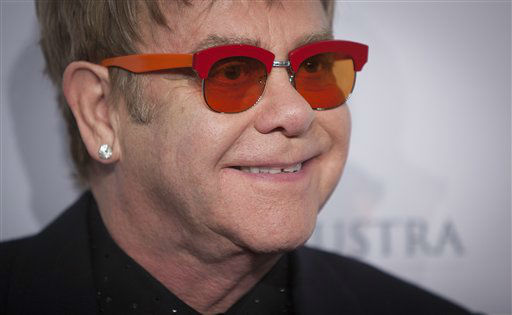 Elton John arrives for the Elton John AIDS Foundation&#39;s 12th Annual &#34;An Enduring Vision&#34; benefit gala at Cipriani Wall Street on Tuesday, Oct. 15, 2013 in New York. &#40;Photo by Carlo Allegri&#47;Invision&#47;AP&#41; <span class=meta>(Photo&#47;Carlo Allegri)</span>