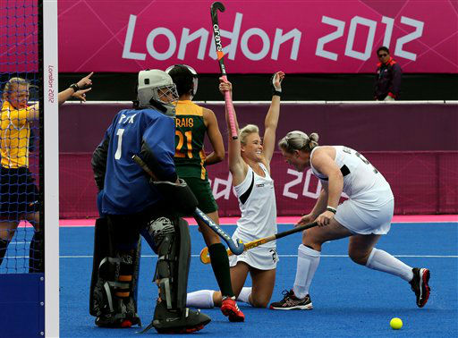 New Zealand&#39;s Samantha Harrison, second right, celebrates after scoring a goal against South Africa during their women&#39;s field hockey preliminary round match at the 2012 Summer Olympics, Tuesday, July 31, 2012, in London. &#40;AP Photo&#47;Eranga Jayawardena&#41; <span class=meta>(AP Photo&#47; Eranga Jayawardena)</span>
