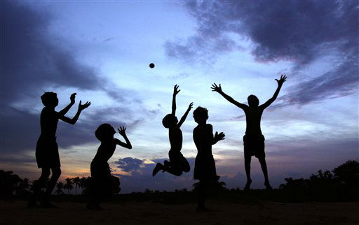 "<div class=""meta image-caption""><div class=""origin-logo origin-image ""><span></span></div><span class=""caption-text"">Indian children play at dusk on the outskirts of the eastern Indian city of Bhubaneswar, India, Thursday, June 20 2013. (AP Photo/Biswaranjan Rout) (AP Photo/ Biswaranjan Rout)</span></div>"