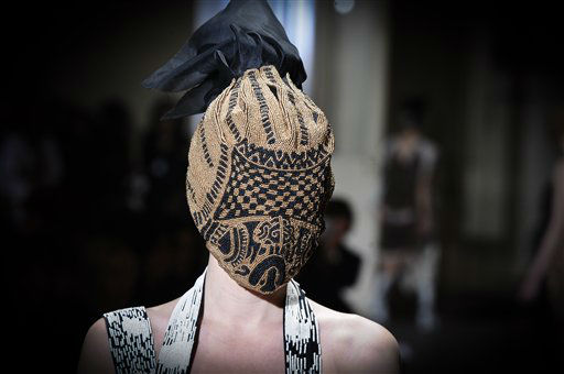 "<div class=""meta ""><span class=""caption-text "">A model wears a creation by fashion designer Martin Margiela as part of his Spring/Summer 2013 Haute Couture fashion collection, in Paris, Wednesday, Jan. 23, 2013. (AP Photo/Zacharie Scheurer)</span></div>"