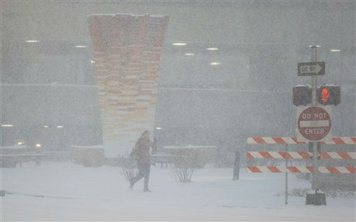 A pedestrian walks along the sidewalk in the Country Club Plaza shopping district in Kansas City, Mo., Thursday, Feb. 21, 2013.  The Missouri Department of Transportation said Interstate 44 near Springfield was completely covered with ice Thursday morning. Traffic was moving very slow and the DOT urged drivers to use extreme caution or stay home. St. Louis-area road crews were out in full force early Thursday, even though it was dry. The region was expecting a volatile mix of snow, sleet, ice and freezing rain by midday and crews were hoping to lay down enough salt to keep at least the major roadways moving. &#40;AP Photo&#47;Orlin Wagner&#41; <span class=meta>(AP Photo&#47; Orlin Wagner)</span>