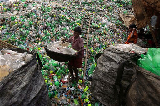 A Bangladeshi child laborer carries empty bottles at a plastic bottle recycling center in Dhaka, Bangladesh, Tuesday, Sept. 18, 2012. &#40;AP Photo&#47;A.M. Ahad&#41; <span class=meta>(AP Photo&#47; A.M. Ahad)</span>