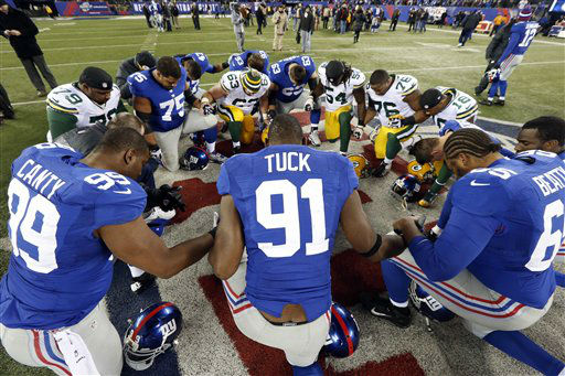 "<div class=""meta ""><span class=""caption-text "">Players for the New York Giants and the Green Bay Packers pray after an NFL football game Sunday, Nov. 25, 2012 in East Rutherford, N.J. The Giants won the game 38-10. (AP Photo/Julio Cortez) (AP Photo/ Julio Cortez)</span></div>"