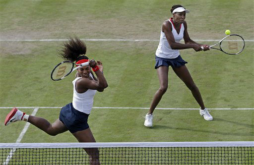 Serena Williams, left, and Venus Williams of the United States compete against Sorana Cirstea and Simona Halep of Romania in womens doubles at the All England Lawn Tennis Club in Wimbledon, London at the 2012 Summer Olympics, Monday, July 30, 2012. &#40;AP Photo&#47;Elise Amendola&#41; <span class=meta>(AP Photo&#47; Elise Amendola)</span>