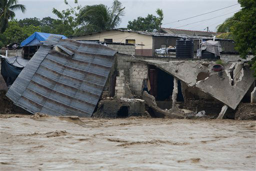 Damaged houses are seen on the shore of a river after heavy rains brought by Hurricane Sandy in Port-au-Prince, Haiti, Thursday, Oct. 25,  2012. Sandy was blamed for the death of an elderly man in Jamaica who was crushed by a boulder. Another man and two women died while trying to cross storm-swollen rivers in southwestern Haiti. &#40;AP Photo&#47;Dieu Nalio Chery&#41; <span class=meta>(AP Photo&#47; Dieu Nalio Chery)</span>