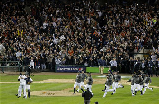 The Detroit Tigers celebrate after winning Game 4 of the American League championship series 8-1, against the New York Yankees, Thursday, Oct. 18, 2012, in Detroit. The Tigers move on to the World Series. &#40;AP Photo&#47;Charlie Riedel&#41; <span class=meta>(AP Photo&#47; Charlie Riedel)</span>