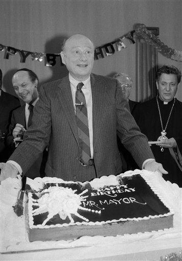 New York City Mayor Ed Koch looks surprised as he displays a birthday cake given to him by seven of the citys top clergymen at a New York television studio, Wednesday, Dec. 12, 1984, New York. Kochs own 60th birthday wish was for good health and happiness for all people of the city, state and world. Rabbi Arthur Schneier, left, and Archbishop Torkom Manoogian, of the Armenian Church, right, stand in the background. &#40;AP Photo&#47;Marty Lederhandler&#41; <span class=meta>(AP Photo&#47; Marty Lederhandler)</span>
