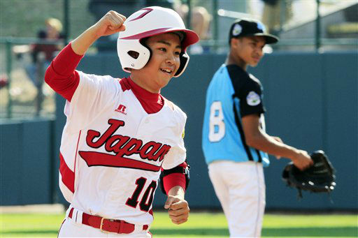 Tokyo, Japan&#39;s Noriatsu Osaka &#40;10&#41; rounds the  bases past Goodlettsville, Tenn., second baseman Lorenzo Butler &#40;8&#41; after hitting a walk-off, two-run home run in the fifth inning of the Little League World Series championship baseball game in South Williamsport, Pa., Sunday, Aug. 26, 2012. Tokyo won 12-2 in five innings. &#40;AP Photo&#47;Gene J. Puskar&#41; <span class=meta>(AP Photo&#47; Gene J. Puskar)</span>