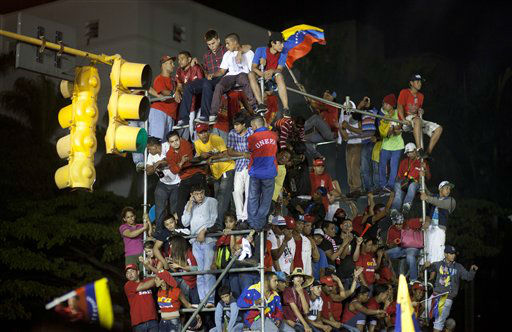 "<div class=""meta ""><span class=""caption-text "">Supporters of President Hugo Chavez celebrate outside the Miraflores presidential palace  in Caracas, Venezuela, Sunday, Oct. 7, 2012. Venezuela's electoral council said late Sunday President Hugo Chavez has won re-election, defeating challenger Henrique Capriles.(AP Photo/Ramon Espinosa) (AP Photo/ Ramon Espinosa)</span></div>"