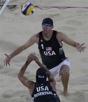 United States&#39; Jake Gibb watches as teammate Sean Rosenthal makes a dig in a beach volleyball match against the Republic of South Africa during a beach volleyball match at the 2012 Summer Olympics, Saturday, July 28, 2012, in London. &#40;AP Photo&#47;Dave Martin&#41; <span class=meta>(AP Photo&#47; Dave Martin)</span>