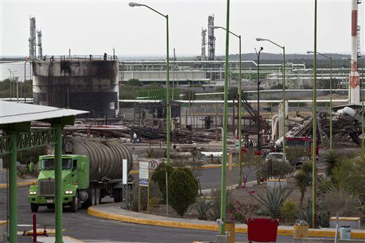 "<div class=""meta image-caption""><div class=""origin-logo origin-image ""><span></span></div><span class=""caption-text"">A truck leaves the badly damaged PEMEX facility after an explosion at  a gas pipeline distribution center in Reynosa, Mexico near Mexico's border with the United States, Tuesday Sept. 18, 2012. A big fire erupted at a natural gas pipeline distribution center near Mexico's border with the United States on Tuesday, and at least 26 people were reported killed. (AP Photo/Hans Maximo Musielik) (AP Photo/ Hans Maximo Musielik)</span></div>"