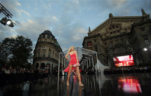 A model presents a creation as part of what is claimed to be the world&#39;s biggest fashion show, by Paris? Galeries Lafayette store, in Paris, Tuesday, Sept. 18, 2012. &#40;AP Photo&#47;Christophe Ena&#41; <span class=meta>(AP Photo&#47; Christophe Ena)</span>