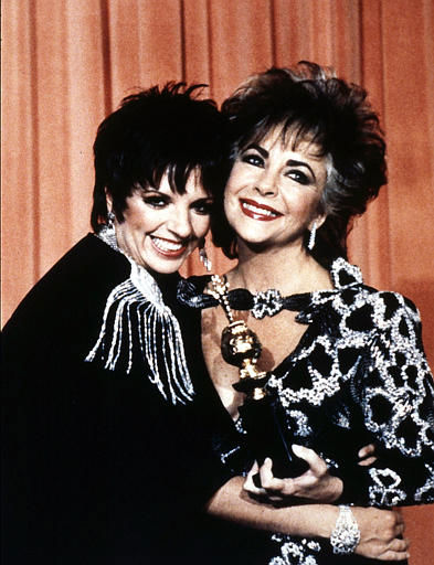 British actress Elizabeth Taylor poses with Liza Minnelli whilst holding her prestigious &#39;Cecil B. DeMille&#39; award, granted for her contribution to the entertainment industry at the 42nd Golden Globe awards ceremony in Beverly Hills, Ca., Jan. 1985. &#40;AP Photo&#47;Liu Heing Shing&#41; <span class=meta>(AP Photo&#47; LIU HEING SHING)</span>