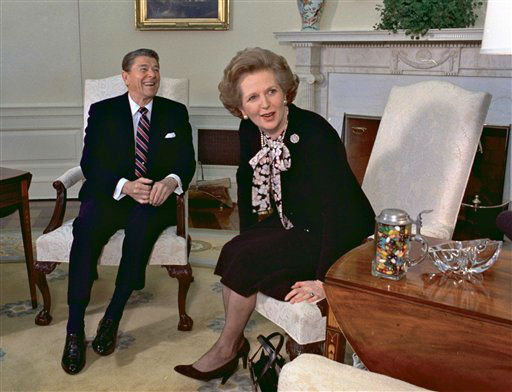 In this file photo from Feb. 20, 1985, former British Prime Minister Margaret Thatcher is seen with her friend and political ally President Ronald Reagan during a visit to the White House in Washington. Thatcher, who led Britain for 11 years, died of a stroke Monday morning, April 8, 2013. &#40;AP Photo&#47;J. Scott Applewhite, file&#41; <span class=meta>(AP Photo&#47; J. SCOTT APPLEWHITE)</span>
