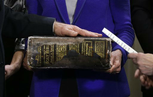 Vice President Joe Biden, left, places his hand on the Biden Family Bible held by his wife Jill Biden, center, as he takes the oath of office from Supreme Court Justice Sonia Sotomayor, right, during and official ceremony at the Naval Observatory, Sunday, Jan. 20, 2013, in Washington. &#40;AP Photo&#47;Carolyn Kaster&#41; <span class=meta>(AP Photo&#47; Carolyn Kaster)</span>