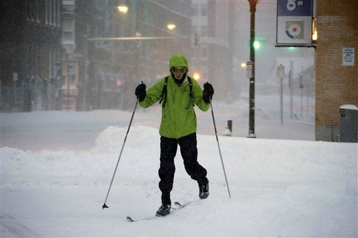 A pedestrian uses skis to travel through the deserted snow-covered streets of Boston early Saturday, Feb. 9, 2013. &#40;AP Photo&#47;Gene J. Puskar&#41; <span class=meta>(AP Photo&#47; Gene J. Puskar)</span>