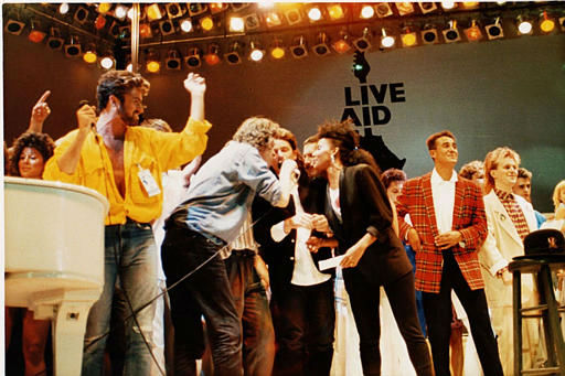 British and Irish singers perform on stage at the Live Aid concert at Wembley Stadium, London, England, July 13, 1985.  From left are George Michael of Wham!, Bob Geldolf, Bono of U2, Freddie Mercury of Queen, Andrew Ridgley of Wham! and Howard Jones.  &#40;AP Photo&#41; <span class=meta>(AP Photo&#47; XNBG)</span>