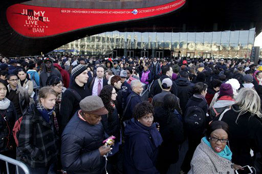 "<div class=""meta ""><span class=""caption-text "">Commuters wait in a line to board buses into Manhattan in front of the Barclays Center in Brooklyn, New York, Thursday, Nov. 1, 2012.  The line stretched twice around the arena and commuters reported wait times of one to three hours to get on a bus. (AP Photo/Seth Wenig) (AP Photo/ Seth Wenig)</span></div>"