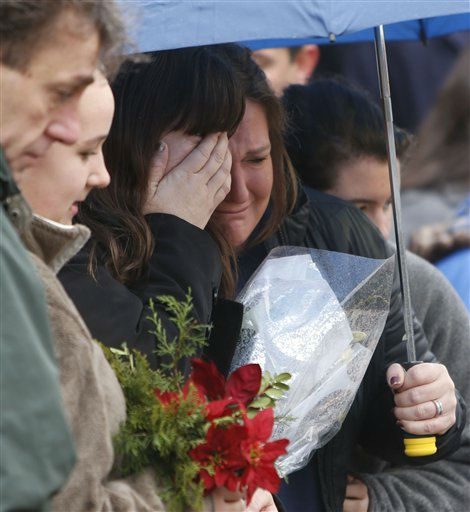 Mourners pay their respects at a memorial for shooting victims near Sandy Hook Elementary School, Sunday, Dec. 16, 2012 in Newtown, Conn.  A gunman walked into Sandy Hook Elementary School in Newtown Friday and opened fire, killing 26 people, including 20 children. &#40;AP Photo&#47;Jason DeCrow&#41; <span class=meta>(AP Photo&#47; Jason DeCrow)</span>