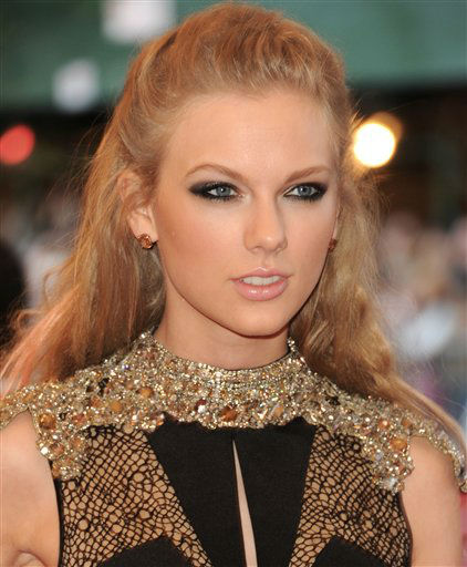 "Singer Taylor Swift attends The Metropolitan Museum of Art Costume Institute gala benefit, ""Punk: Chaos to Couture"", on Monday, May 6, 2013 in New York. (Photo by Evan Agostini/Invision/AP)"
