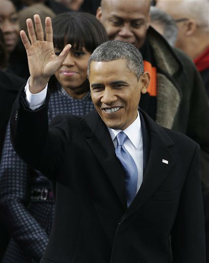 With his wife Michelle at his shoulder, President Barack Obama waves to crowds gather for his ceremonial swearing-in at the U.S. Capitol during the 57th Presidential Inauguration in Washington, Monday, Jan. 21, 2013. &#40;AP Photo&#47;Pablo Martinez Monsivais&#41; <span class=meta>(AP Photo&#47; Pablo Martinez Monsivais)</span>