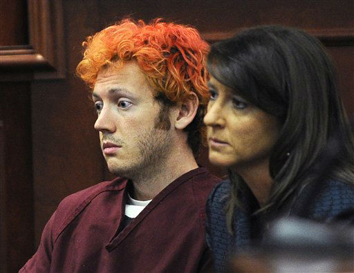 FILE - In this Monday, July 23, 2012 file photo, James Holmes, accused of killing 12 people in Friday&#39;s shooting rampage in an Aurora, Colo., movie theater, appears in Arapahoe County District Court with defense attorney Tamara Brady in Centennial, Colo.  Colorado prosecutors are filing formal charges Monday July 30, 2012, against Holmes, the former neuroscience student accused of killing 12 people and wounding 58 others at an Aurora movie theater.   &#40;AP Photo&#47;Denver Post, RJ Sangosti, Pool, File&#41; <span class=meta>(AP Photo&#47; RJ Sangosti)</span>
