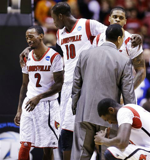 Louisville&#39;s Russ Smith &#40;2&#41;, Gorgui Dieng &#40;10&#41; and Montrezl Harrell, right, react after guard Kevin Ware suffered a lower right leg injury during the first half of the Midwest Regional final against Duke in the NCAA college basketball tournament, Sunday, March 31, 2013, in Indianapolis. Ware had to be taken off the court on a stretcher. &#40;AP Photo&#47;Michael Conroy&#41; <span class=meta>(AP Photo&#47; Michael Conroy)</span>
