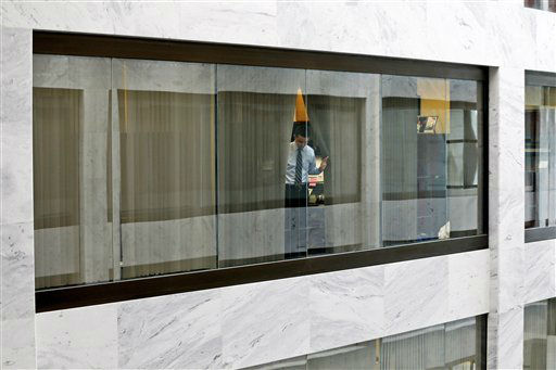 "<div class=""meta ""><span class=""caption-text "">An unidentified staff member looks out from his office window down into the atrium of the Hart Senate Office Building on Capitol Hill in Washington, Wednesday, April 17, 2013, after they were told to shelter in place after reports of suspicious packages discovered on Capitol Hill. U.S. Capitol police are investigating the discovery of at least two suspicious envelopes in Senate office buildings across the street from the Capitol. (AP Photo/Charles Dharapak) (AP Photo/ Charles Dharapak)</span></div>"