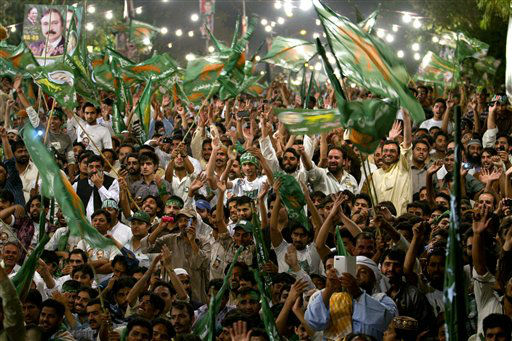 "<div class=""meta ""><span class=""caption-text "">Supporters of Pakistan Muslim League-N party cheer their leader, Nawaz Sharif, not pictured, during an election campaign rally in Islamabad, Pakistan, Sunday, May 5, 2013. Pakistan is scheduled to hold parliamentary elections on May 11, the first transition between democratically elected governments in a country that has experienced three military coups and constant political instability since its creation in 1947. (AP Photo/Anjum Naveed) (AP Photo/ Anjum Naveed)</span></div>"