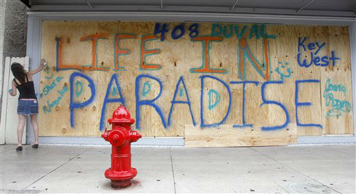 Shira Edllan Gervasi, of Israel, puts her name on plywood protecting a storefront in Key West, Fla., in anticipation of Tropical Storm Isaac on Saturday, Aug. 25, 2012.  Isaac&#39;s winds are expected to be felt in the Florida Keys by sunrise Sunday morning. &#40;AP Photo&#47;Alan Diaz&#41; <span class=meta>(AP Photo&#47; Alan Diaz)</span>