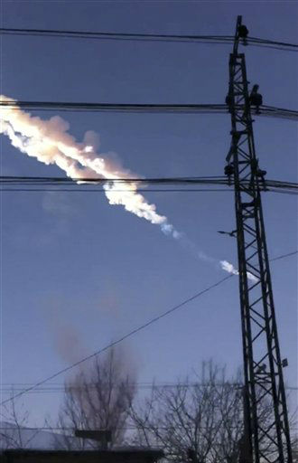 In this photo taken with a mobile phone camera, a meteorite contrail is seen in Chelyabinsk region on Friday, Feb. 15, 2013. A meteor streaked across the sky of Russia?s Ural Mountains on Friday morning, causing sharp explosions and reportedly injuring around 100 people, including many hurt by broken glass. &#40;AP Photo&#47;Sergey Hametov&#41; <span class=meta>(AP Photo&#47; Sergey Hametov)</span>
