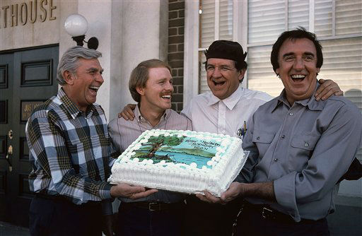 Ron Howard, second from left, who played ?Opie? on the ?Mayberry? television series, gets a birthday cake from fellow cast members Andy Griffith, left, George Lindsay second from right, and Jim Nabors on the set of ?Return to Mayberry,? in Los Olivos, California  Feb. 27, 1986. Howard will turn 32  March 1. They will all recreate their roles in the upcoming two-hour NBC-TV movie. &#40;AP Photo&#41; <span class=meta>(AP Photo&#47; Anonymous)</span>