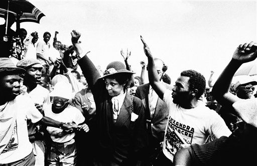 Winnie Mandela, wife of jailed ANC Leader Nelson Mandela, raises her fist during the funeral for 17 blacks who were buried, after being killed during fierce rioting on Wednesday, March 5, 1986 in South Africa Johannesburg&#39;s Alexandra black township&#40;AP Photo&#41; &#34;South Africa out&#34; <span class=meta>(AP Photo&#47; Anonymous)</span>