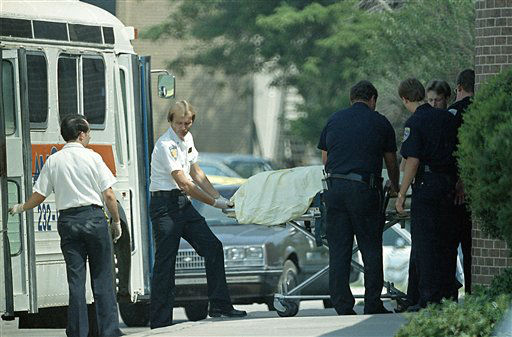 ** ADVANCE FOR SUNDAY AUG. 20 ** FILE **Members of the Edmond, Okla., police department and medical personnel remove one of those killed in a shooting spree   Aug. 20, 1986 at the Edmond Post Office in Edmond, Okla.   On Aug. 20, 1986, Patrick Henry Sherrill, an ex-Marine and small arms instructor for the Oklahoma Air National Guard, tucked two .45-caliber pistols into his postal satchel, locked the doors and systematically killed 14 people before killing himself inside a suburban Oklahoma City post office. &#40;AP Photo&#47;Steve Gooch&#41; <span class=meta>(AP Photo&#47; STEVE GOOCH)</span>